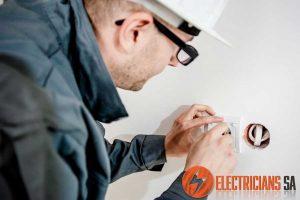 Electrician Fixing Faulty Plug